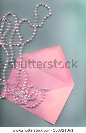 beauty background with pearl and envelope - stock photo