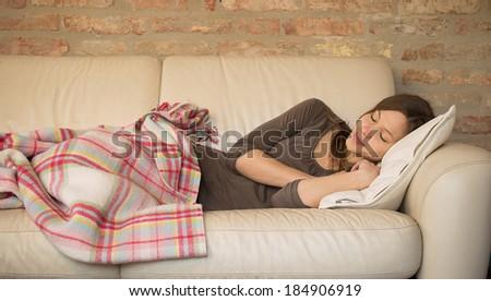 Beauty girl sleeping on the sofa - stock photo