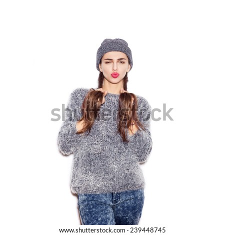 Beauty girl with bright make-up holding two braids.  - stock photo