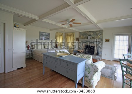 """""""Bed & Breakfast"""" An interior view of a cozy B&B room. - stock photo"""