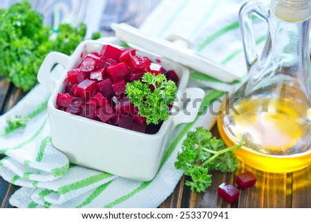 beet salad in bowl and on a table - stock photo