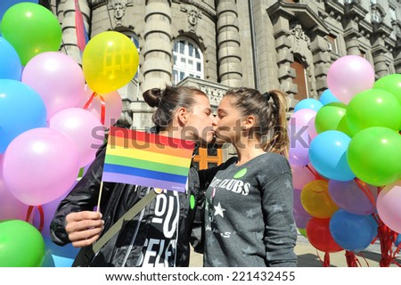 Belgrade, Serbia - September 28, 2014:In second gay pride parade in Serbia revellers carrying banners and flags at Belgrade Gay pride 2014 - stock photo