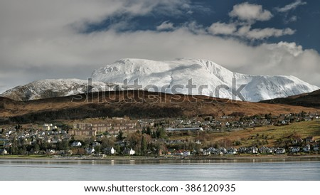 Ben Nevis mountain range and the town of Fort William from Trislaig. Scotland.