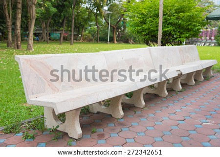 Bench in a Beautiful Park - stock photo