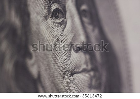 Benjamin Franklin Portrait from Hundred Dollar Bill of American Currency, narrow focus on eyes. - stock photo