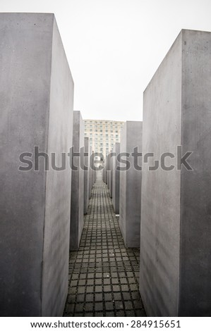 BERLIN, GERMANY - SEPTEMBER 20: The Memorial to the Murdered Jews of Europe  on September 20, 2013 in Berlin, Germany. It was designed by Peter Eisenman and Buro Happold. - stock photo