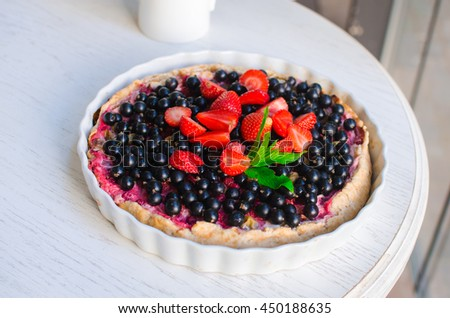 berry cheesecake . Pie with ripe summer berries . Black currants , strawberries