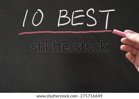 10 best words written on the blackboard using chalk - stock photo