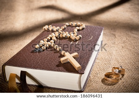 bible and wedding rings - stock photo