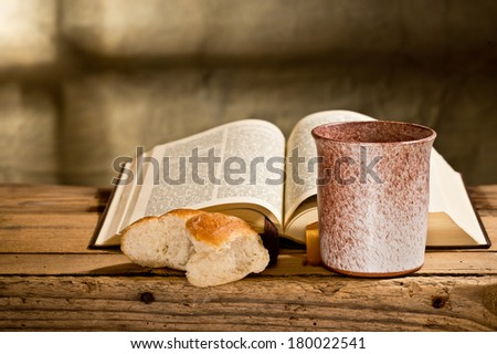 Bible chalice and bread - stock photo