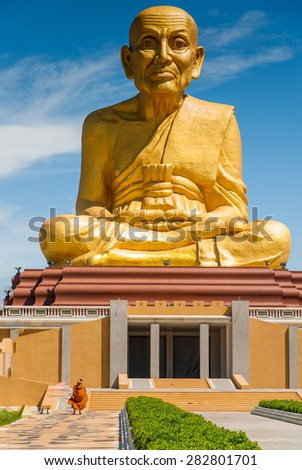 big golden monk statue, Thailand - stock photo