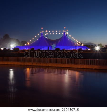 """Big Top"" circus style blue tent on the bank of Corrib river in Galway, Ireland - stock photo"