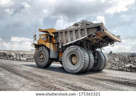 big truck transport iron ore in career - stock photo