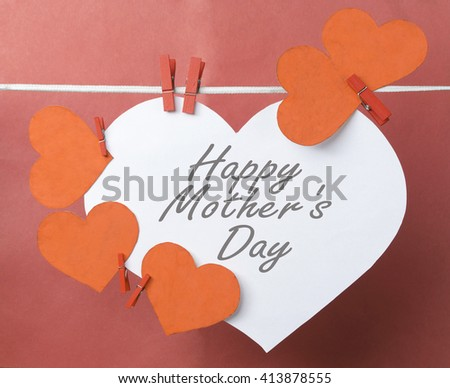 big white Heart and red little hanging on the clothesline.  text - Happy Mother's Day. On color background. Romantic date, invitation card, Happy Valentines Day concept. Toned image - stock photo