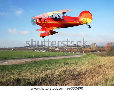 Biplane landing at shoreham airport - stock photo
