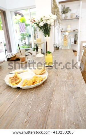 biscuit plate on wood table - stock photo