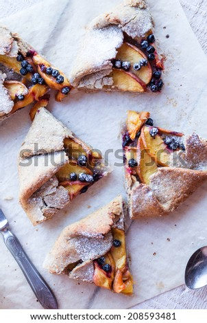 biscuits with peach and blueberry, top view - stock photo