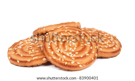 Biscuits with sesame seeds on a white background