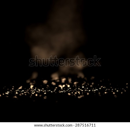 Black and Gold Festive Abstract background. Christmas twinkled bright background with bokeh defocused white and silver  lights. Magic texture