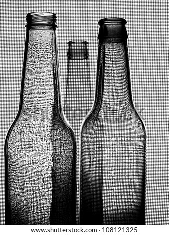 Black and white abstract  background design of three beer bottles