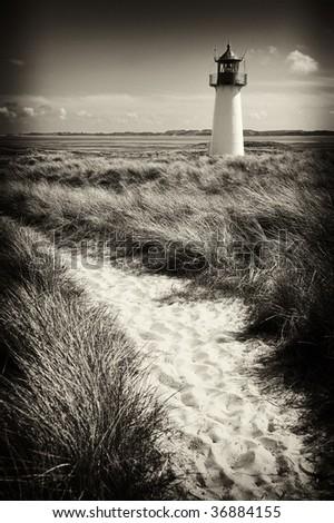 """Black and white"" lighthouse way summer island solitude dunes - stock photo"