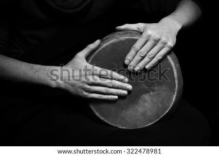 black and white photo of hand drum - stock photo