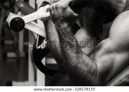 Black and white photos of the athlete in the gym. Photos for sporting magazines and websites.  - stock photo