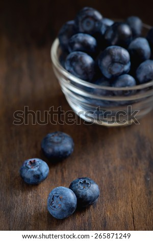 black currant on wooden table - stock photo