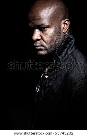 """Black """"gangster men"""" looking serious high contrast low key. - stock photo"""