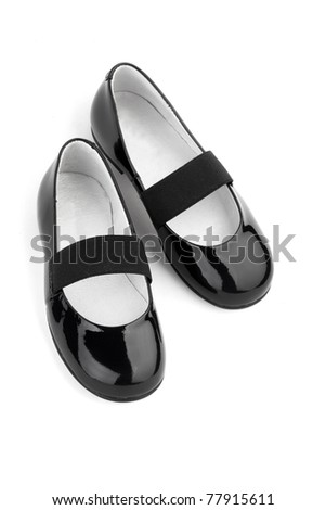 Black shine leather girl shoes isolated on white