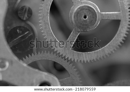 Black white background with metal cogwheels a clockwork.  For your successful business design. Macro. - stock photo