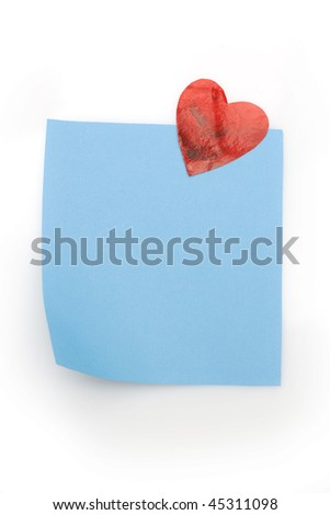 blank blue note with heart magnet - stock photo