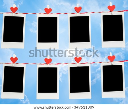 8 Blank instant photo and red clip paper heart hanging on the clothesline with blue sky nature and cloud background..Designer concept. - stock photo