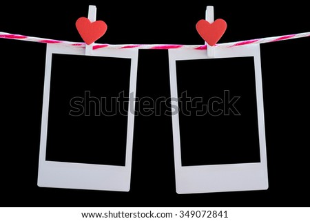 2 Blank instant photo and red clip paper heart hanging on the clothesline with wood background.Designer concept. - stock photo