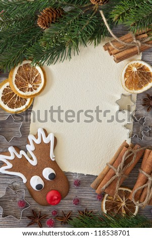 Blank note and christmas cakes on wooden background - stock photo