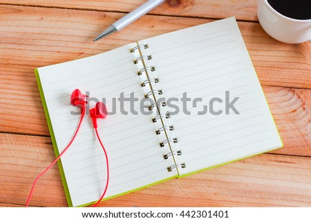 Blank notebook and pen, coffee cup texture background for your design, business concept - stock photo