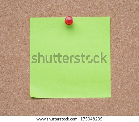 Blank notebook paper Pinned to the cork board.