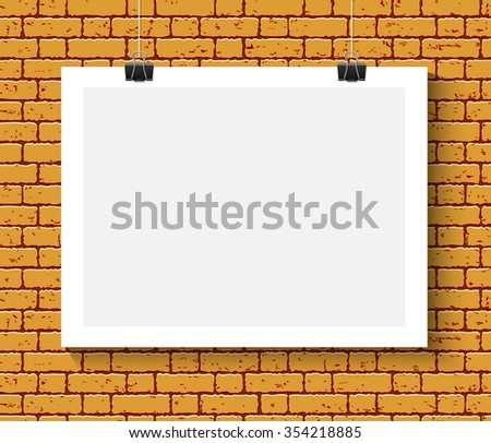 Blank paper poster mock up on orange brick wall. Template of a paper sheet with clips. Paper card hanging on the rop. - stock photo