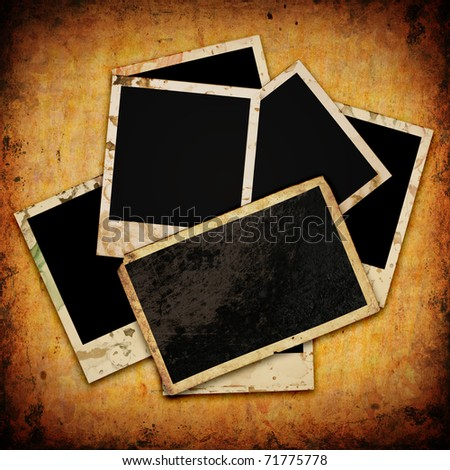 Blank photo frame on the grunge wood background