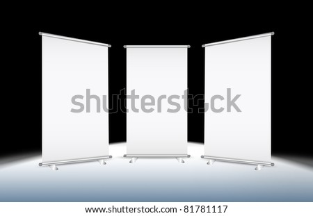 3 Blank roll-up banner against a black background with paths - stock photo