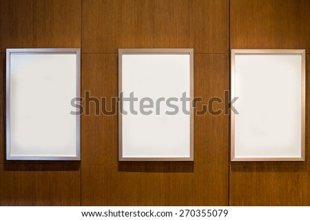 3 Blank white paper canvas photo  frame on the wood wall for a bulletin - stock photo