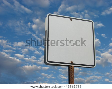 Blank white sign with cloudy sky - stock photo
