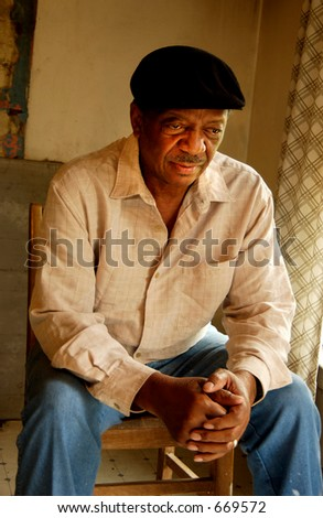 Blind african american senior man  wearing beret - stock photo