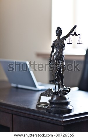 """""""Blind Lady Justice"""" statue on desk - stock photo"""