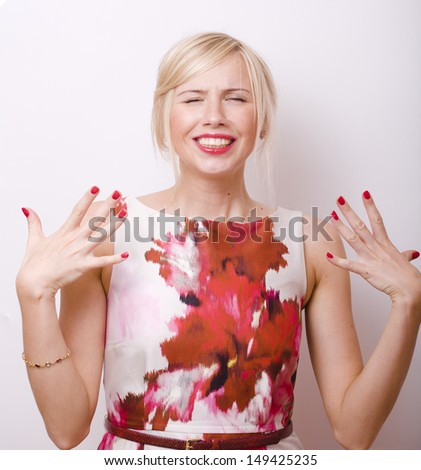 blond emotional woman with red lips and nails - stock photo