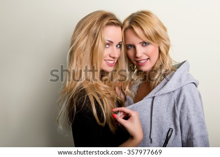 blond haired girls friends laughing and hug - stock photo