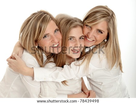 3 blond sisters of different ages in a hug smiling to the camera - stock photo