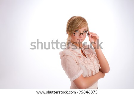 blonde businesswoman on white background in business attire adjusting her glasses - stock photo