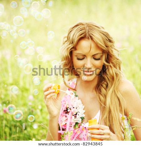 Blonde starts soap bubbles