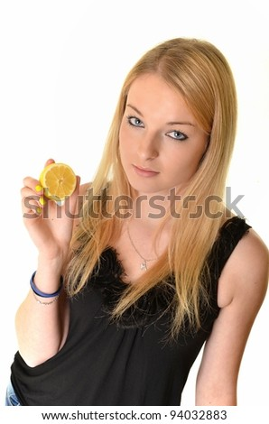 blonde woman with  lemon isolated on white